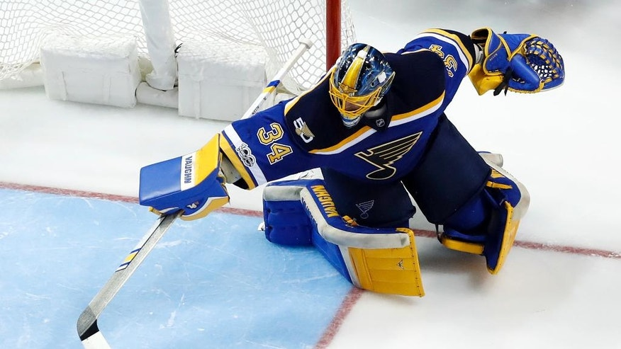 St. Louis Blues goalie Jake Allen reaches for the puck as it slides by during the second period of an NHL hockey game against the Arizona Coyotes, Monday, March 27, 2017, in St. Louis. (AP Photo/Jeff Roberson)