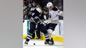 Columbus Blue Jackets defenseman Kyle Quincey, left, works against Buffalo Sabres forward Nicolas Deslauriers during the first period of an NHL hockey game in Columbus, Ohio, Tuesday, March 28, 2017. (AP Photo/Paul Vernon)