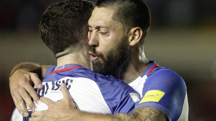 United States' Christian Pulisic, left, celebrates with teammate United States' Clint Dempsey after he scored against Panama during a a 2018 World Cup qualifying soccer match in Panama City, Tuesday, March 28, 2017. (AP Photo/Arnulfo Franco)
