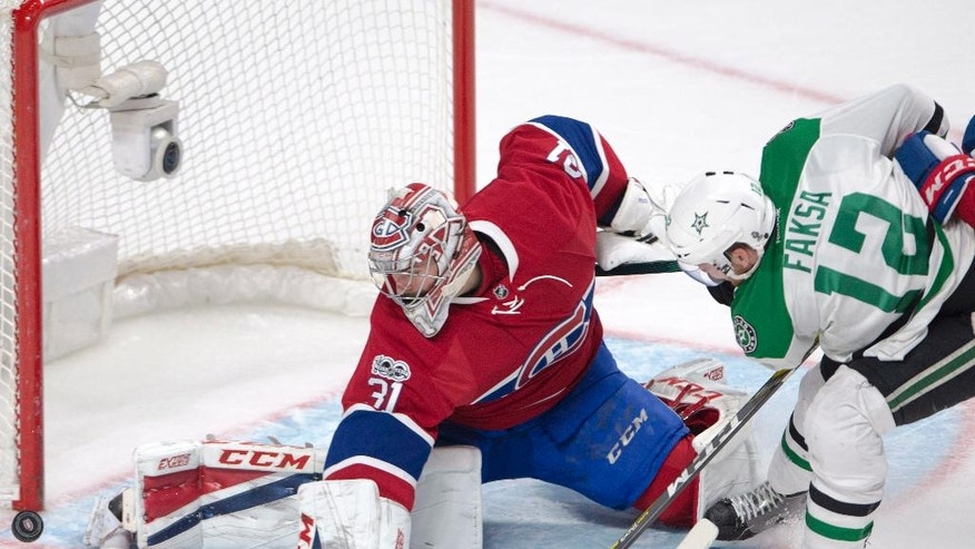 Montreal Canadiens goalie Carey Price (31) stops Dallas Stars center Radek Faksa (12) during the second period of an NHL hockey game in Montreal on Tuesday, March 28, 2017. (Ryan Remiorz/The Canadian Press via AP)