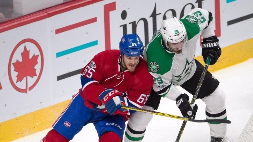 Montreal Canadiens center Andrew Shaw (65) vies with Dallas Stars defenseman Greg Pateryn (29) for a loose puck during the first period of an NHL hockey game in Montreal on Tuesday, March 28, 2017. (Ryan Remiorz/The Canadian Press via AP)