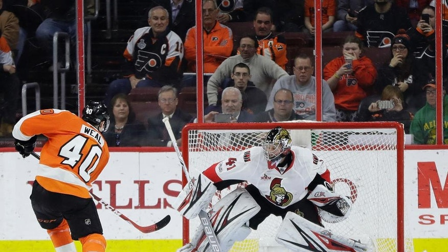 Philadelphia Flyers' Jordan Weal, left, scores a goal against Ottawa Senators' Craig Anderson during a shootout in an NHL hockey game, Tuesday, March 28, 2017, in Philadelphia. Philadelphia won 3-2. (AP Photo/Matt Slocum)