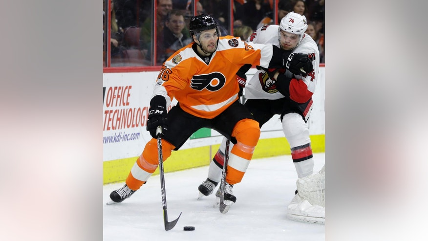 Philadelphia Flyers' Chris VandeVelde, left, tries to keep Ottawa Senators' Mark Borowiecki away during the second period of an NHL hockey game, Tuesday, March 28, 2017, in Philadelphia. (AP Photo/Matt Slocum)