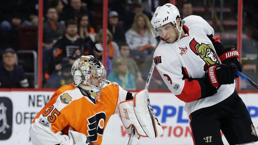 Philadelphia Flyers' Steve Mason, left, blocks a shot past Ottawa Senators' Bobby Ryan during the first period of an NHL hockey game, Tuesday, March 28, 2017, in Philadelphia. (AP Photo/Matt Slocum)