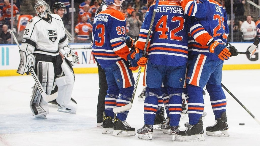 Los Angeles Kings goalie Jonathan Quick (32) looks on as the Edmonton Oilers celebrate a goal during second period NHL hockey action in Edmonton, Alberta, on Tuesday, March 28, 2017. (Jason Franson/The Canadian Press via AP)