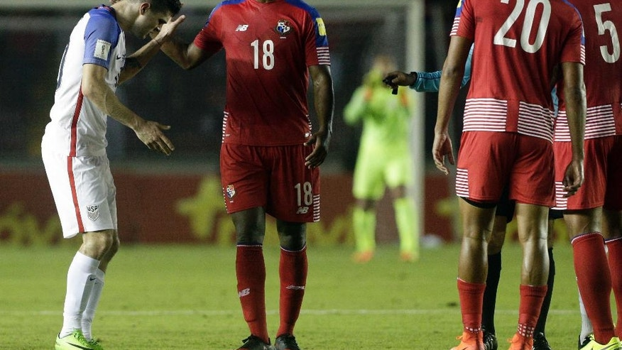 United States' Christian Pulisic, left, crosses words with Panama's Luis Tejada, center, during a a 2018 World Cup qualifying soccer match in Panama City, Tuesday, March 28, 2017. (AP Photo/Arnulfo Franco)