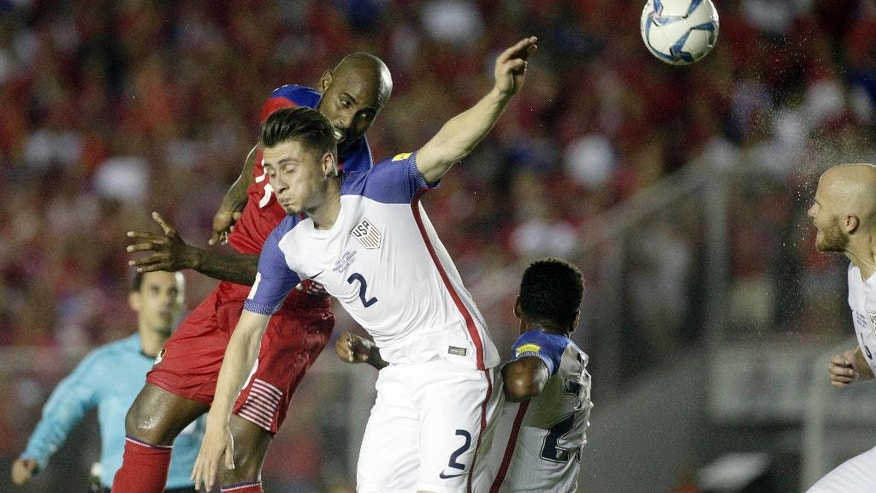 Panama's Felipe Baloy, left, heads the ball as United States' Jorge Villafana, center, challenges and Michael Bradley, right, heads it back during a 2018 World Cup qualifying soccer match in Panama City, Tuesday, March 28, 2017. (AP Photo/Arnulfo Franco)