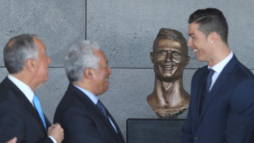 Portuguese president Marcelo Rebelo de Sousa, left, Portuguese Prime Minister Antonio Costa and Cristiano Ronaldo standing next to the bust Wednesday.