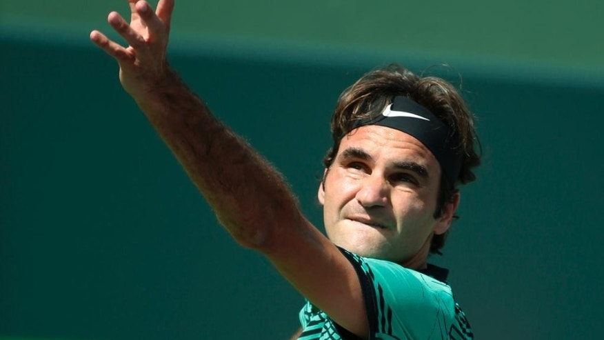 Federer saves match points to beat Berdych in Miami quarter-final