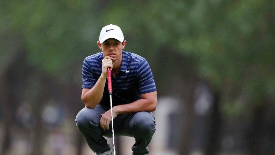 FILE - In this March 3, 2017, file photo, Rory McIlroy, of Northern Ireland, looks over the 17th green during the second round of the Mexico Championship golf tournament at Chapultepec Golf Club in Mexico City. (AP Photo/Eduardo Verdugo, File)