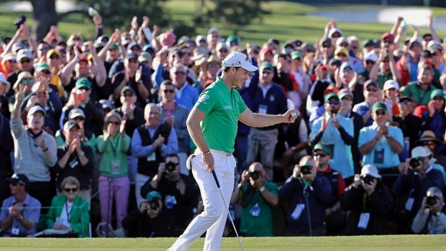 FILE - in this April 10, 2016, file photo, Danny Willett, of England, celebrates on the 18th hole after finishing the final round of the Masters golf tournament in Augusta, Ga. Willett won the tournament. (AP Photo/Charlie Riedel, File)