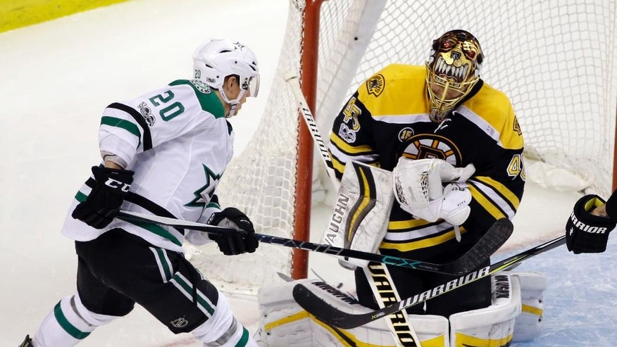 Boston Bruins goalie Tuukka Rask (40) makes a save as Dallas Stars center Cody Eakin (20) looks for a rebound during the third period of an NHL hockey game, Thursday, March 30, 2017, in Boston. The Bruins won 2-0. (AP Photo/Elise Amendola)