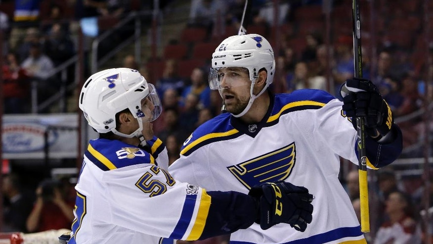 St. Louis Blues center Patrik Berglund (21) celebrates with David Perron after scoring a goal in the first period during an NHL hockey game against the Arizona Coyotes, Wednesday, March 29, 2017, in Glendale, Ariz. (AP Photo/Rick Scuteri)