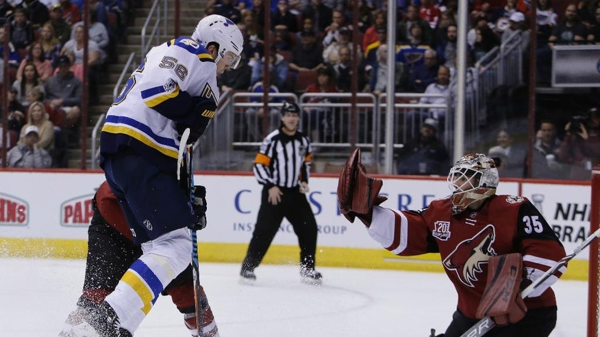 Arizona Coyotes goalie Louis Domingue (35) makes the save on St. Louis Blues left wing Magnus Paajarvi (56) in the first period during an NHL hockey game, Wednesday, March 29, 2017, in Glendale, Ariz. (AP Photo/Rick Scuteri)