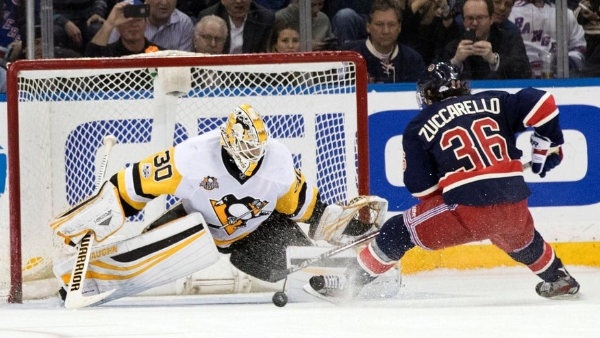 Pittsburgh Penguins goalie Matt Murray (30) stops New York Rangers right wing Mats Zuccarello (36) from scoring during the shootout of an NHL hockey game, Friday, March 31, 2017, at Madison Square Garden in New York. The Penguins won 4-3. (AP Photo/Mary Altaffer)