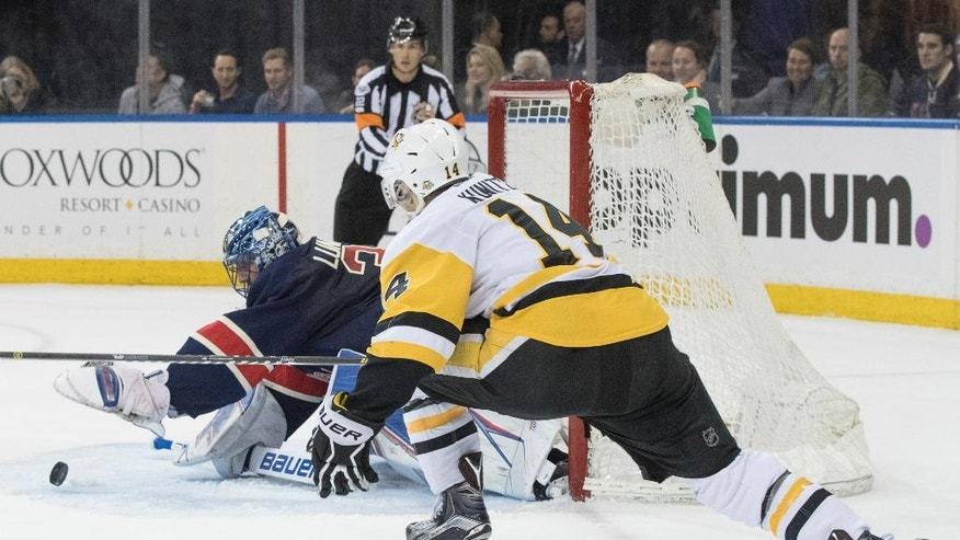 New York Rangers goalie Henrik Lundqvist (30) tends the net against Pittsburgh Penguins left wing Chris Kunitz (14) during the first period of an NHL hockey game, Friday, March 31, 2017, at Madison Square Garden in New York. (AP Photo/Mary Altaffer)