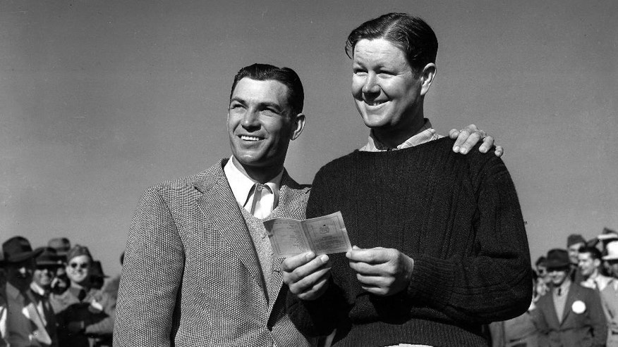 FILE -  In this in this April 12, 1942 file photo, Ben Hogan, left, and Byron Nelson pose after they were tied with a score of 280 at the conclusion of the 72-hole Masters Golf Tournament in Augusta, Ga.  (AP Photo/File)