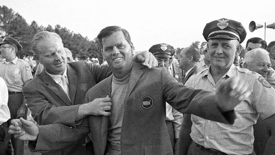 FILE - In this April 9, 1967, file photo, Gay Brewer grins as Jack Nicklaus, left, helps him into his traditional green jacket after winning the Masters golf tournament at Augusta National Golf Club in Augusta, Ga. (AP Photo/File)