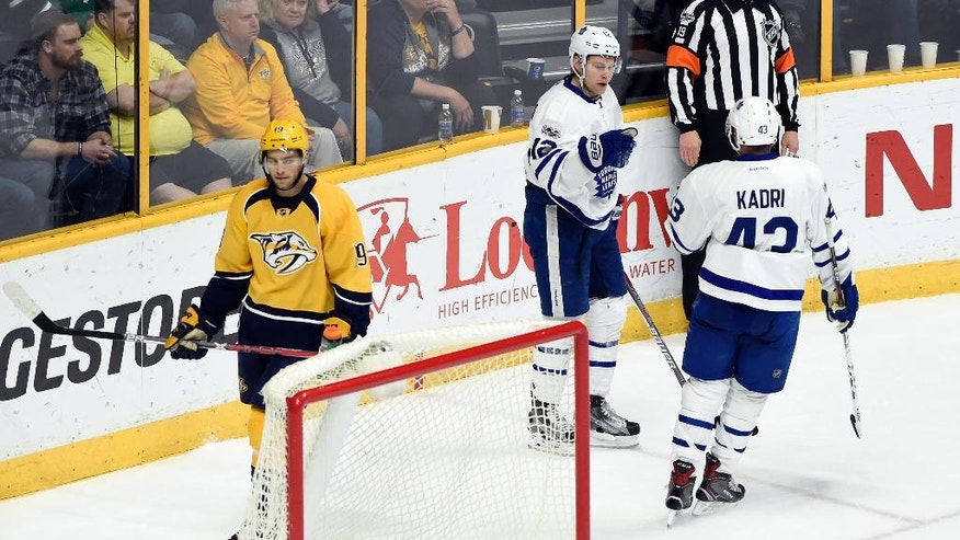 Toronto Maple Leafs right wing Connor Brown (12) is congratulated by center Nazem Kadri (43) after scoring a empty net goal against the Nashville Predators during the third period of an NHL hockey game Thursday, March 30, 2017, in Nashville, Tenn. Nashville Predators' Calle Jarnkrok (19), of Sweden, skates behind the net. (AP Photo/Mark Zaleski)
