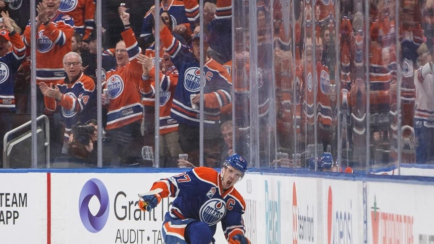 Edmonton Oilers' Connor McDavid (97) celebrates a short-handed goal against the San Jose Sharks during the first period of an NHL hockey game Thursday, March 30, 2017, in Edmonton, Alberta. (Jason Franson/The Canadian Press via AP)