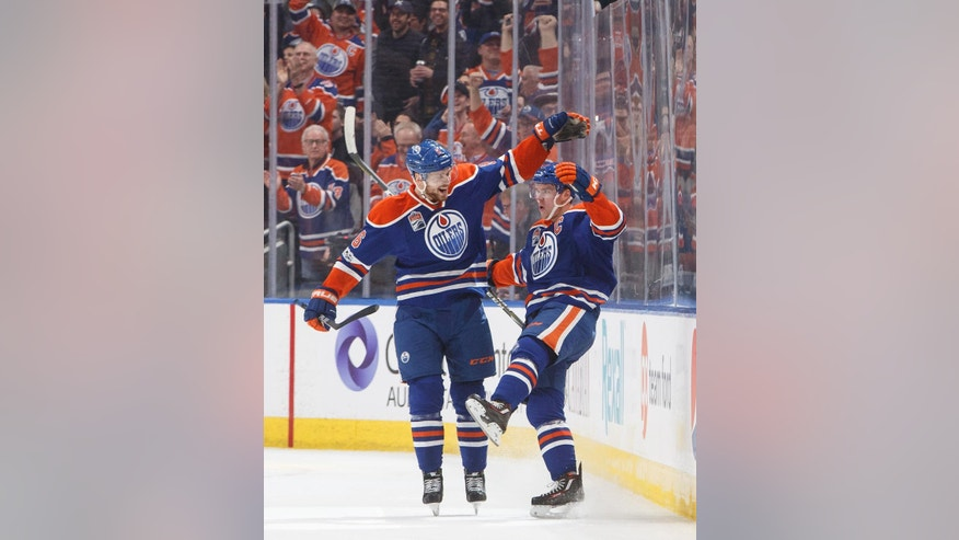 Edmonton Oilers' Adam Larsson (6) and Connor McDavid (97) celebrate a short-handed goal against the San Jose Sharks during the first period of an NHL hockey game Thursday, March 30, 2017, in Edmonton, Alberta. (Jason Franson/The Canadian Press via AP)