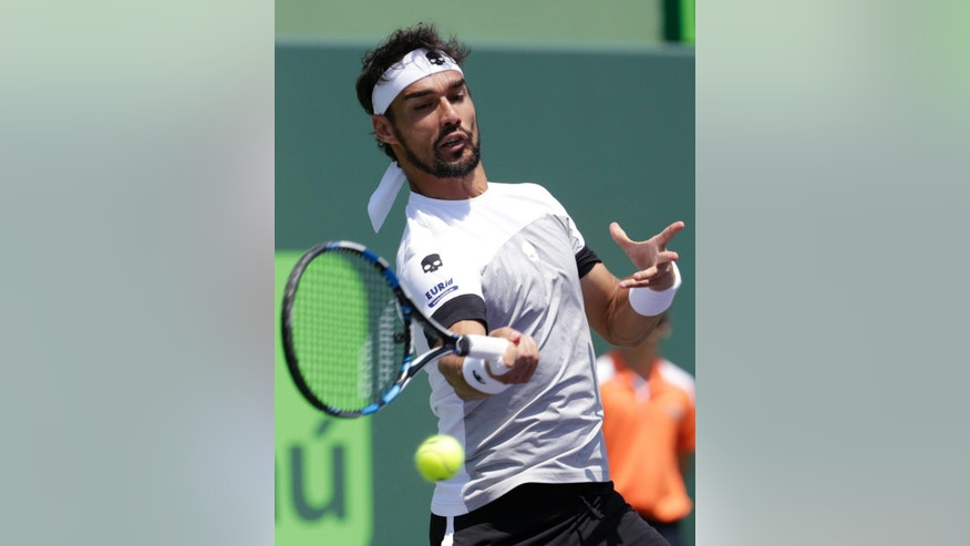 Fabio Fognini, of Italy, hits a return to Rafael Nadal during a men's semifinal match at the Miami Open tennis tournament, Friday, March 31, 2017, in Key Biscayne, Fla. (AP Photo/Lynne Sladky)