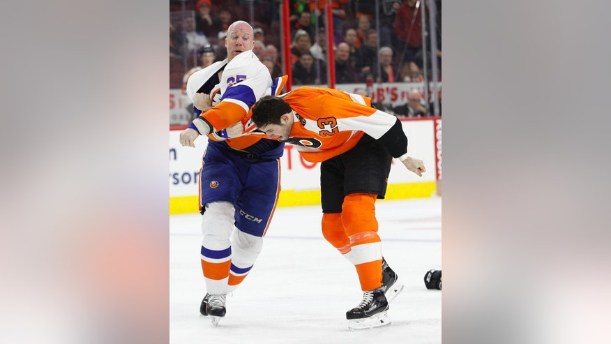 New York Islanders' Jason Chimera, left, fights with Philadelphia Flyers' Brandon Manning, right, during the third period of an NHL hockey game, Thursday, March 30, 2017, in Philadelphia. (AP Photo/Chris Szagola)