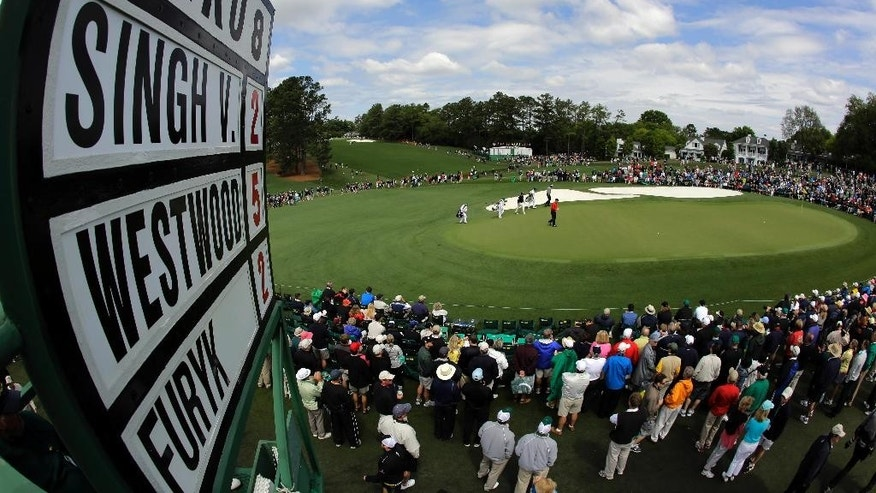 "FILE- In this April 6, 2012, file photo, Lee Westwood, of England, Vijay Singh, of Fiji, and Jim Furyk walk up to the ninth green during the second round the Masters golf tournament in Augusta, Ga. If the Masters doesn't really begin until the back nine Sunday, the final place to build, or lose, momentum is the 460-yard ninth hole known as ""Carolina Cherry."" (AP Photo/Charlie Riedel, File)"