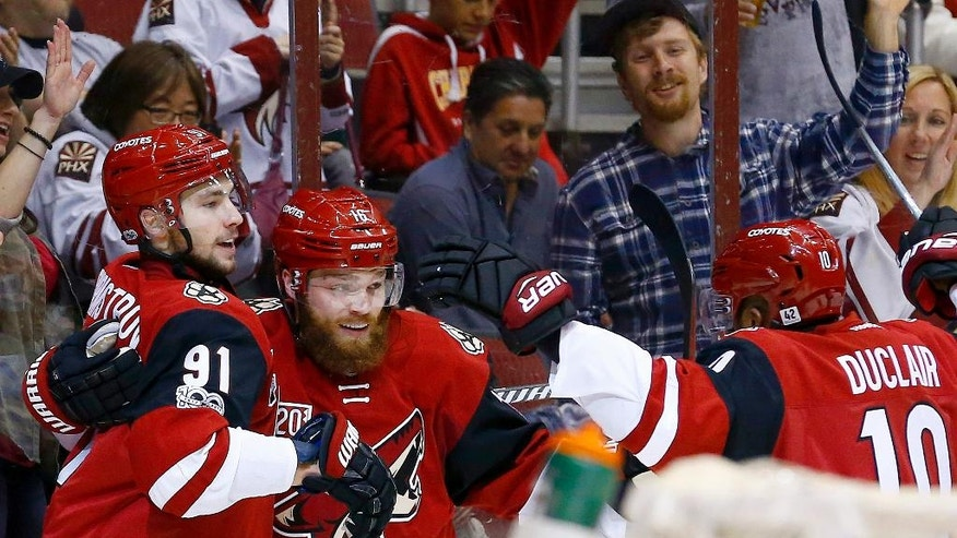 Arizona Coyotes' Alexander Burmistrov (91) celebrates his goal against the Washington Capitals with Max Domi (16) and Anthony Duclair (10) during the second period of an NHL hockey game Friday, March 31, 2017, in Glendale, Ariz. (AP Photo/Ross D. Franklin)