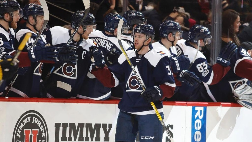Colorado Avalanche left wing J.T. Compher, front, is congratulated after scoring a goal against the St. Louis Blues in the second period of an NHL hockey game Friday, March 31, 2017, in Denver. (AP Photo/David Zalubowski))