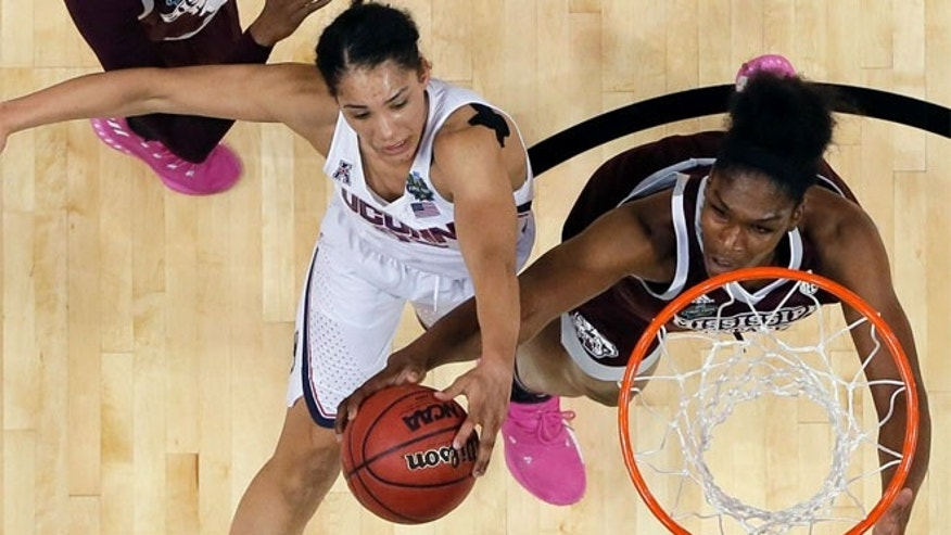 Connecticut guard Gabby Williams, left, is blocked by Mississippi State center Teaira McCowan