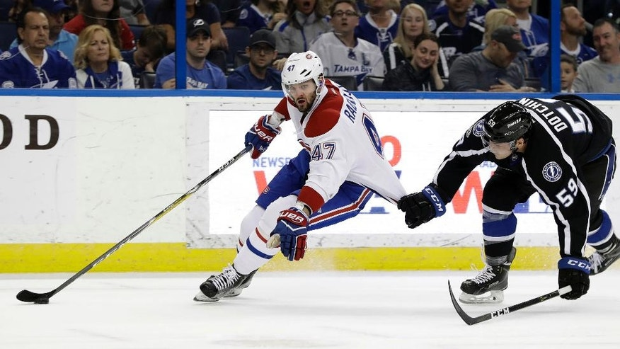 Tampa Bay Lightning defenseman Jake Dotchin (59) hangs onto Montreal Canadiens right wing Alexander Radulov (47) during the first period of an NHL hockey game Saturday, April 1, 2017, in Tampa, Fla. (AP Photo/Chris O'Meara)