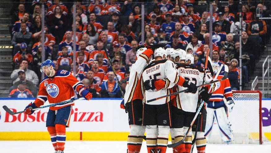 Anaheim Ducks celebrate a goal as Edmonton Oilers' Mark Letestu (55) skates by during the second period of an NHL hockey game Saturday, April 1, 2017, in Edmonton, Alberta. (Jason Franson/The Canadian Press via AP)