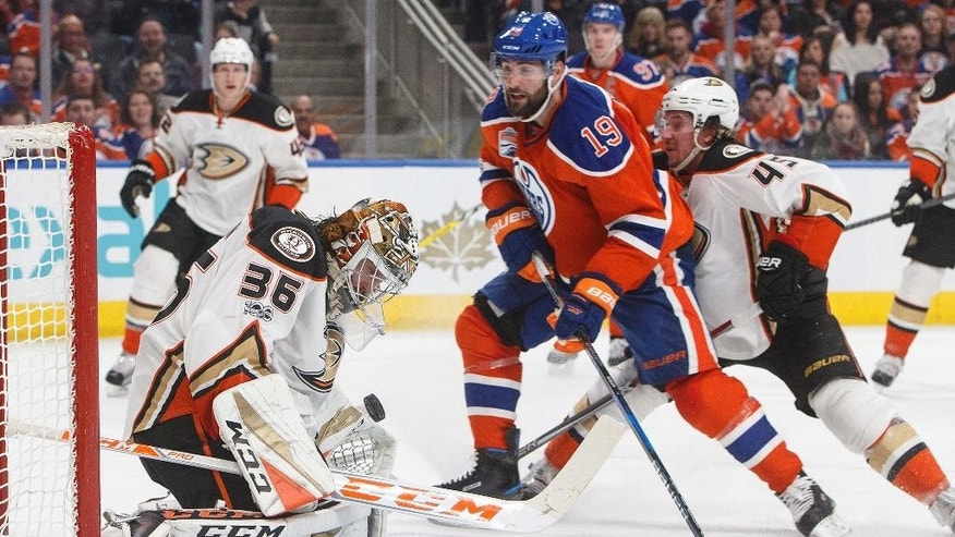 Anaheim Ducks goalie John Gibson (36) makes a save on Edmonton Oilers' Patrick Maroon (19) during the second period of an NHL hockey game Saturday, April 1, 2017, in Edmonton, Alberta. (Jason Franson/The Canadian Press via AP)