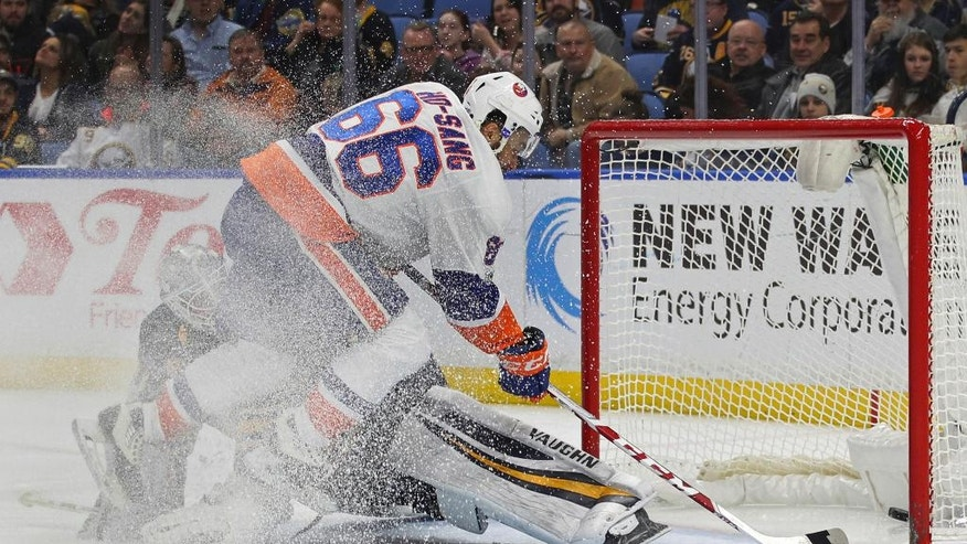 New York Islanders forward Joshua Ho-Sang (66) puts the puck past Buffalo Sabres goalie Robin Lehner (40) during the second period of an NHL hockey game, Sunday, April 2, 2017, in Buffalo, N.Y. (AP Photo/Jeffrey T. Barnes)