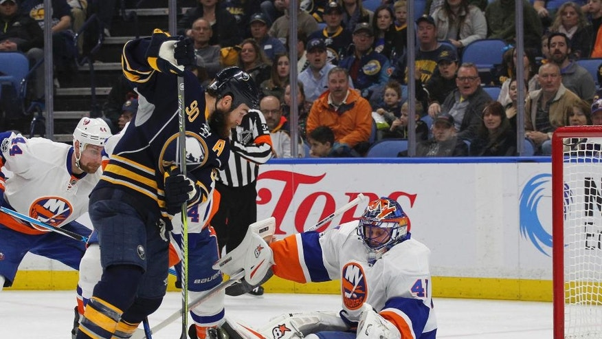 Buffalo Sabres' Ryan O'Reilly (90) is stopped by New York Islanders goalie Jaroslav Halak (41) during the first period of an NHL hockey game, Sunday, April 2, 2017, in Buffalo, N.Y. (AP Photo/Jeffrey T. Barnes)