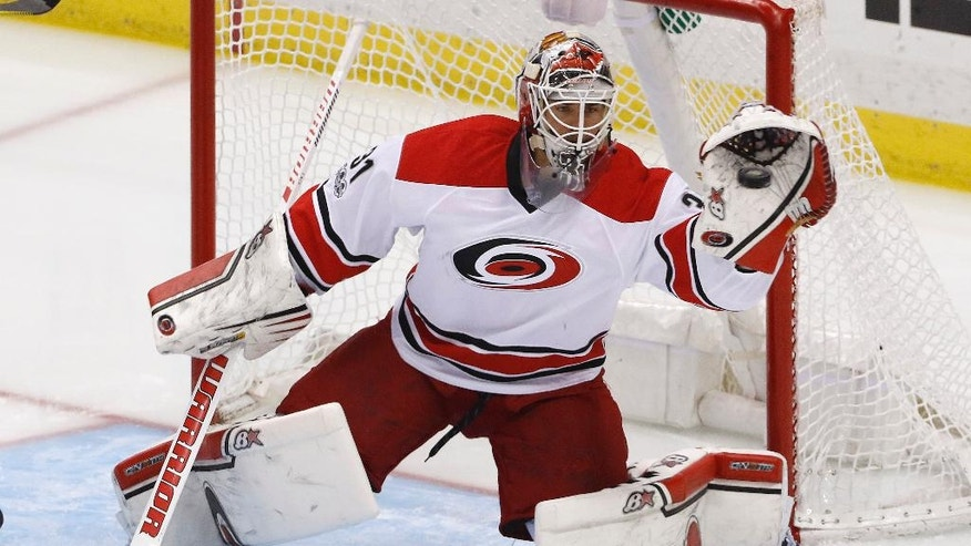 Carolina Hurricanes goalie Eddie Lack gloves a shot during the first period of the team's NHL hockey game against the Pittsburgh Penguins in Pittsburgh, Sunday, April 2, 2017. (AP Photo/Gene J. Puskar)