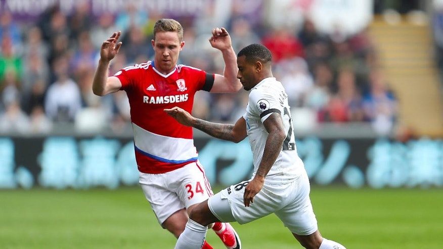 Middlesbrough's Adam Forshaw, left, and Swansea City's Luciano Narsingh in action during their English Premier League soccer match at the Liberty Stadium in Swansea, England, Sunday April 2, 2017. (David Davies/PA via AP)