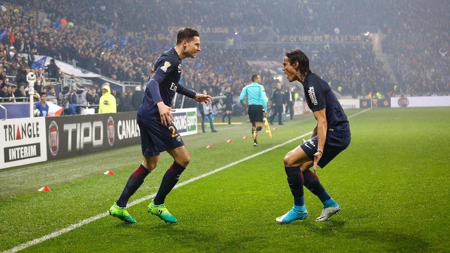 Paris Saint Germain's Julian Draxler, left, and Roberto Edinson Cavani, celebrate after Draxler scored a goal against Monaco during their League Cup final soccer match in Decines, near Lyon, central France, Saturday, April 1, 2017. (AP Photo/Laurent Cipriani)