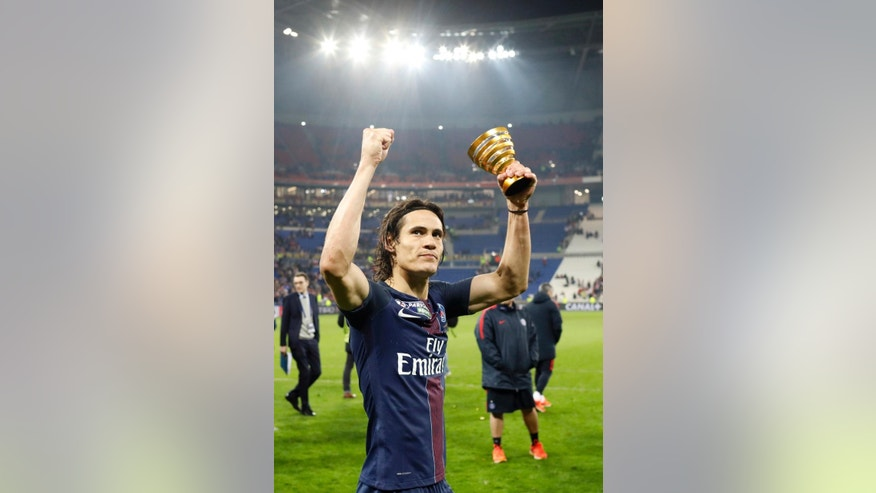 Paris Saint Germain's Roberto Edinson Cavani celebrates with his trophy after winning the League Cup final soccer match against Monaco, in Decines, near Lyon, central France, Saturday, April 1, 2017. (AP Photo/Laurent Cipriani)