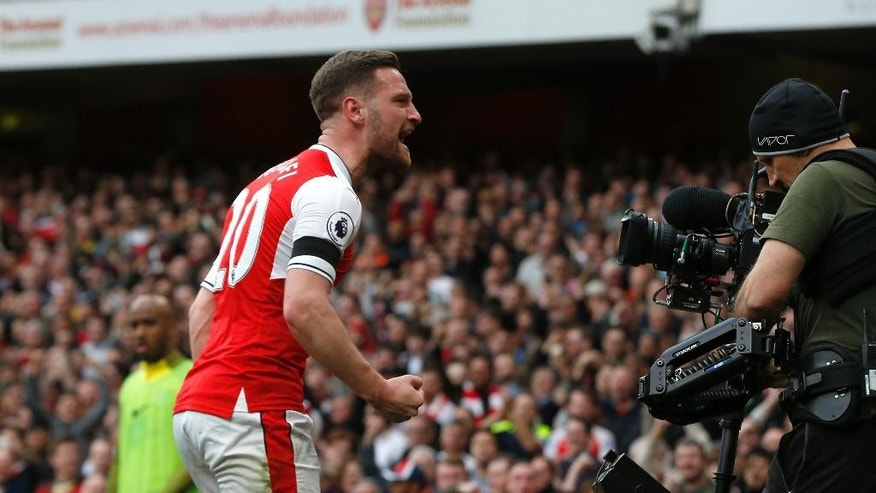 Arsenal's Shkodran Mustafi celebrates after scoring his side's second goal during the English Premier League soccer match between Arsenal and Manchester City at the Emirates stadium in London, Sunday, April 2, 2017. (AP Photo/Alastair Grant)