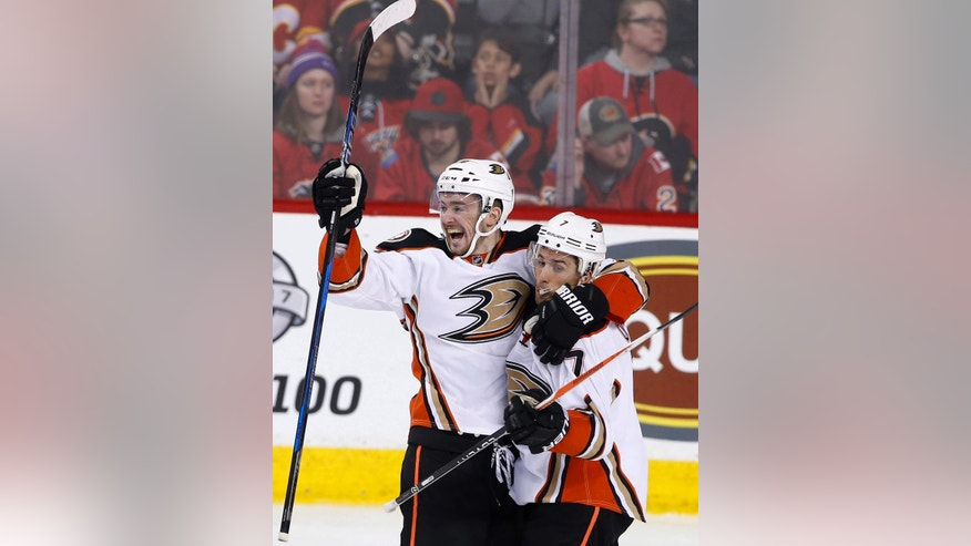 Anaheim Ducks' Logan Shaw, left, celebrates his goal with Andrew Cogliano against the Calgary Flames during the third period of an NHL hockey game in Calgary, Alberta, Sunday, April 2, 2017. (Larry MacDougal/The Canadian Press via AP)