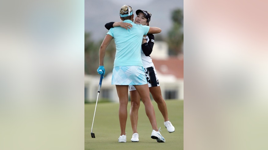 Lexi Thompson, left, congratulates So Yeon Ryu, of South Korea, after Ryu made a birdie putt on the playoff hole to win the LPGA Tour's ANA Inspiration golf tournament at Mission Hills Country Club in Rancho Mirage, Calif., Sunday, April 2, 2017. (AP Photo/Alex Gallardo)