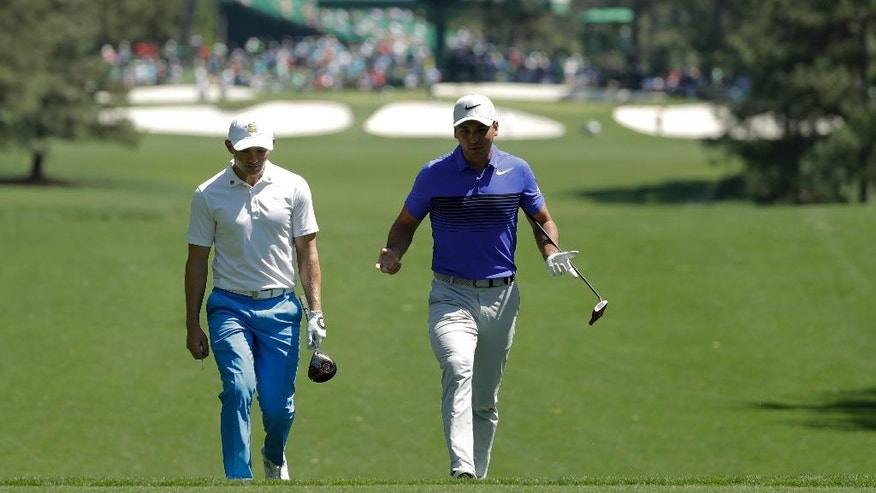 Scott Gregory, of England, left, and Jason Day, of Australia, chat on the seventh fairway during a practice round for the Masters golf tournament Tuesday, April 4, 2017, in Augusta, Ga. (AP Photo/Matt Slocum)