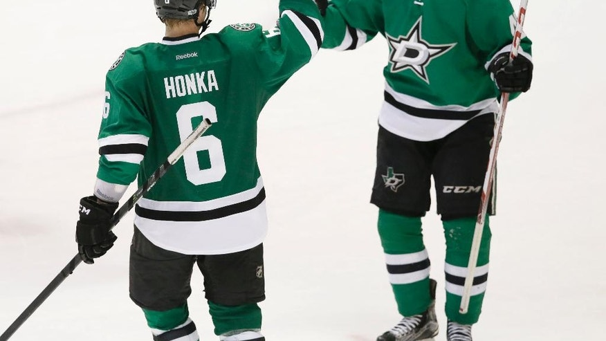 Dallas Stars defenseman Julius Honka (6) celebrates his game-winning goal with teammate Gemel Smith in overtime during an NHL hockey game against the Arizona Coyotes in Dallas, Tuesday, April 4, 2017. The Stars won 3-2. (AP Photo/LM Otero)