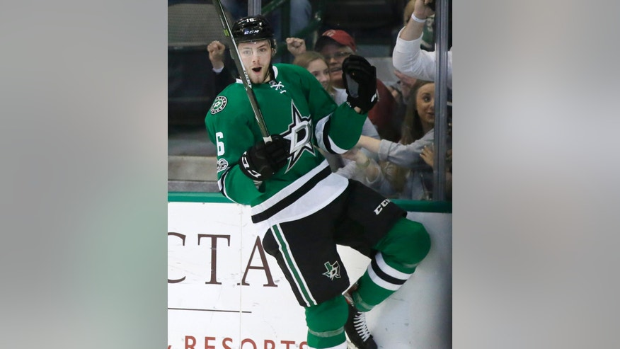 Dallas Stars center Jason Dickinson celebrates his goal during the first period of the team's NHL hockey game against the Arizona Coyotes in Dallas, Tuesday, April 4, 2017. (AP Photo/LM Otero)