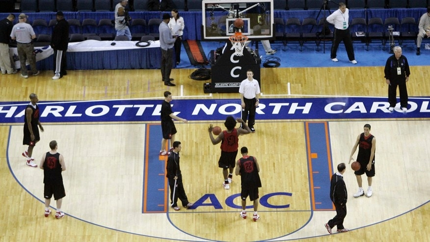 "FILE - In this March 12, 2008, file photo, Maryland players practice for the Atlantic Coast Conference men's NCAA college basketball tournament at Bobcats Arena in Charlotte, N.C.  The NCAA says it will consider North Carolina as a host for championship events again after the state rolled back a law that limited protections for LGBT people. In a statement Tuesday, April 4, 2017, the governing body said its Board of Governors had reviewed moves to repeal repealed the so-called ""bathroom bill"" and replace it with a compromise law. (AP Photo/Gerry Broome, File)"
