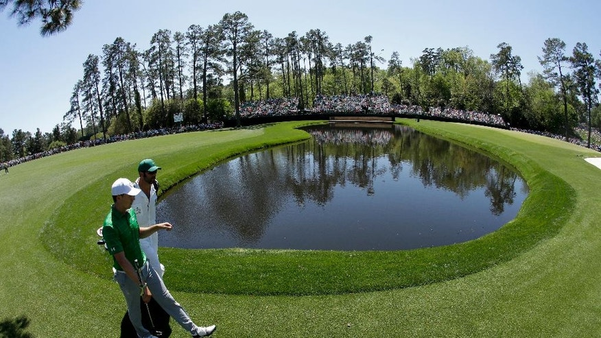 Jordan Spieth walks to the 15th green with his caddie during a practice round for the Masters golf tournament Tuesday, April 4, 2017, in Augusta, Ga. (AP Photo/Charlie Riedel)