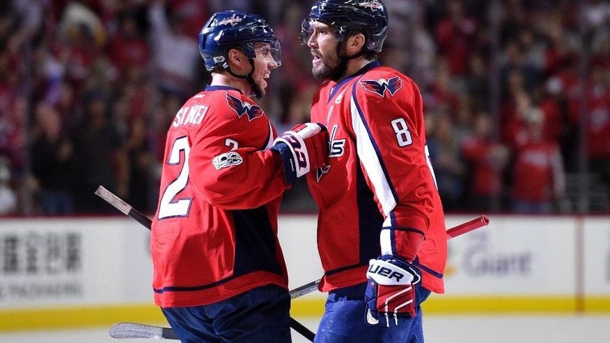 UPDATES SCORER OF GOAL, AFTER CHANGE IN SCORING - Washington Capitals left wing Alex Ovechkin (8), of Russia, celebrates a Capitals goal by Justin Williams with defenseman Matt Niskanen (2) during the second period of an NHL hockey game against the New York Rangers, Wednesday, April 5, 2017, in Washington. Ovechkin had an assist on the goal.  (AP Photo/Nick Wass)