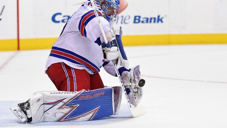 New York Rangers goalie Henrik Lundqvist (30), of Sweden, stops the puck during the second period of an NHL hockey game against the Washington Capitals, Wednesday, April 5, 2017, in Washington. (AP Photo/Nick Wass)